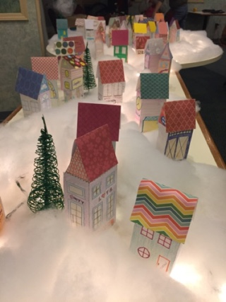 small paper craft houses in cotton ball landscape